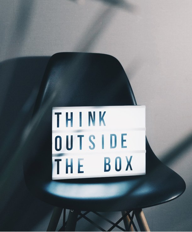 Sign on chair - think outside the box